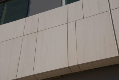 Close up image of finished precision cut exterior Stone Panels Dallas project at the University of Texas.