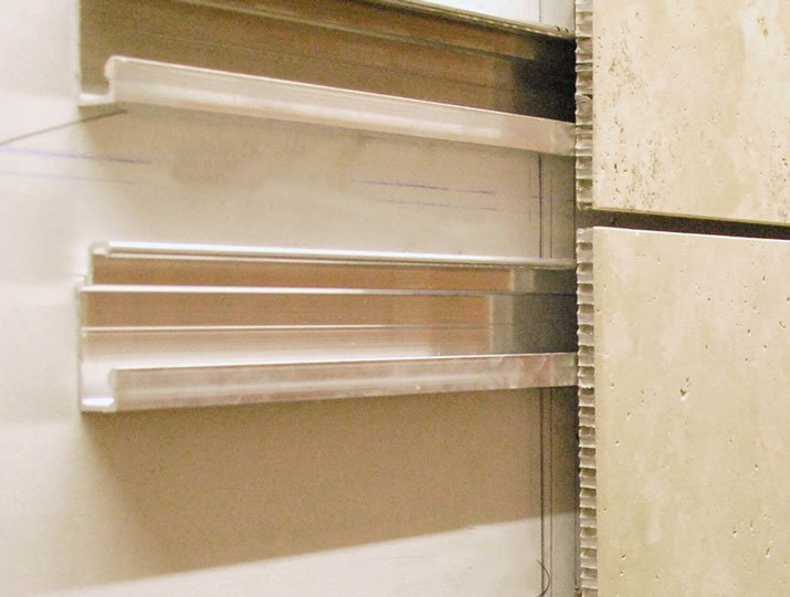 Close up of Trimstone Lightweight Panel System's aluminum mounting and honeycomb panel system.