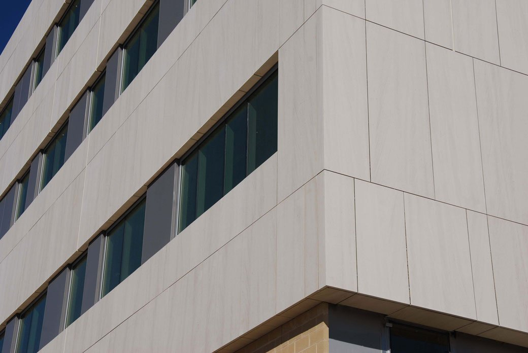 Close up image of finished exterior Stone Panels Dallas project at the University of Texas.