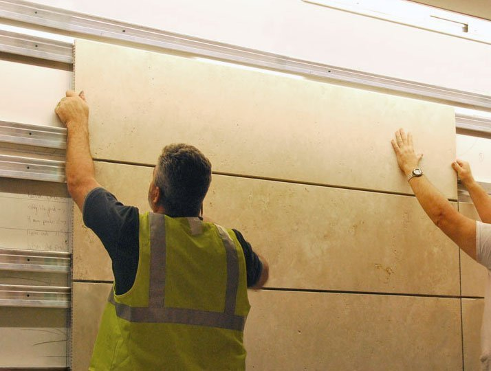 Two Men Installing Trimstone Lightweight Panel System